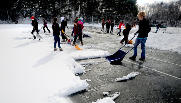 Amesbury: Members of the Amesbury boys and girls tennis teams traded their rackets for shovels for their first day of spring practice. Jim Vaiknoras/staff photo