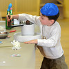 Newburyport: Max Kerstein, 5, grinds wheat into flour at a program Sunday at Ahavas Achim. The event put on by Travelling Matzah Bakery taught kids to make Matzah from scratch. Jim Vaiknoras/staff photo