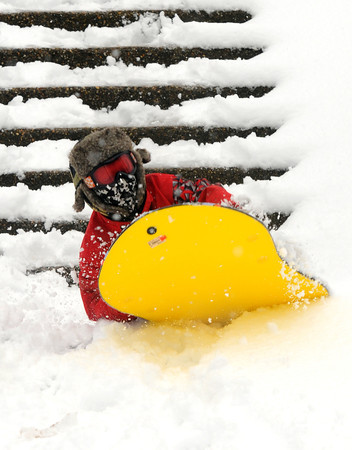 Newburyport: Casey Holmes kicks up some snow as he sleds on Marches Hilll iN Newburyport Tuesday. Casey along with his friend Zack Engelhardt took advantage of a day off from school due to the snow. Jim Vaiknoras/staff photo