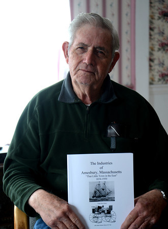 Amesbury: Royal Feltner with his book The Industries of Amesbury,. Jim Vaiknoras/staff photo
