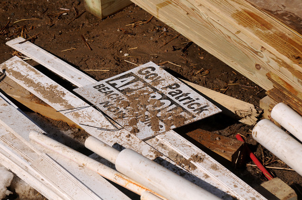 Newbury: A sign asking Gov Patrick to approve beach scraping is amongst the debris on Annapolis Way on Plum Island after Friday's storm. Jim Vaiknoras/staff photo