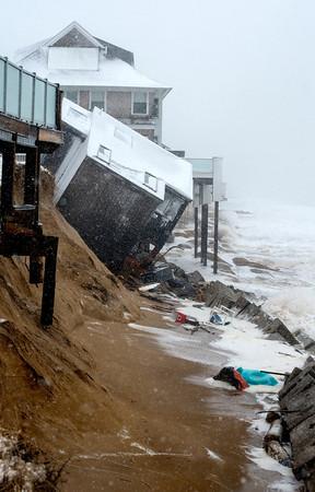 Newbury:41 Annapolis Way on Plum Island after it was damaged at high tide. Jim Vaiknoras/staff photo