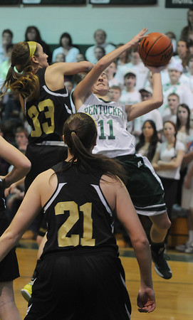 West Newbury: Pentucket's Alex Moore is fouled by  Bishop Fenwick's Kaitlyn Lipka during their game at Pentucket Saturday afternoon. JIm Vaiknoras/staff photo