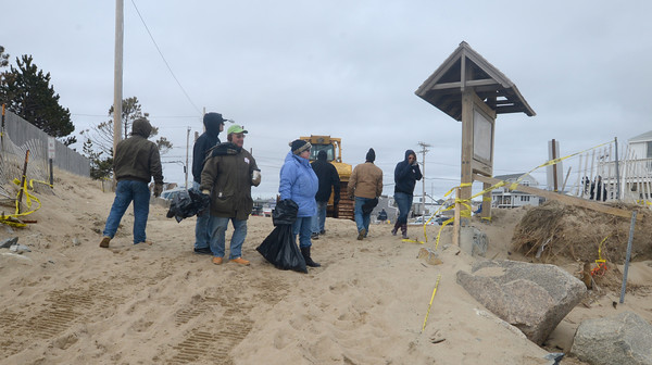 Newbury: Volunteers head out to pick up debris on Plum Island. A group of about 40 people pitch in to clean up the beach Monday morning. Jim Vaiknoras/staff photo