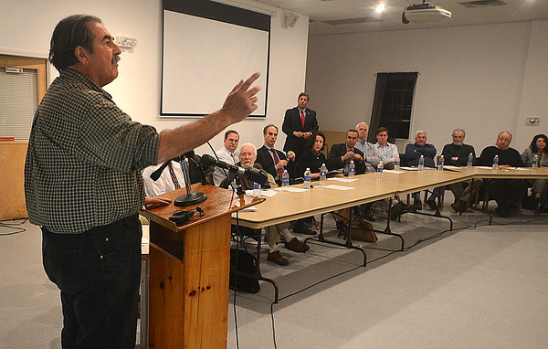 Newbury: Steve Bandoian, owner of 41 Annapolis Way on Plum Island which was destroyed in a storm earlier this month, speaks at the Coastal Hazard Mitigation Meeting at the Fireman's Memorial Hall in Newbury Tuesday night. Jim Vaiknoras/staff photo