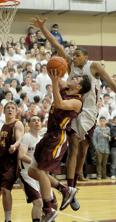 haverhill: Newburyport's Colton Fontaine is fouled by Whittier's Justin Wells as he tries to lay the ball in during their game at Whittier Friday night. Jim Vaiknoras/staff photo