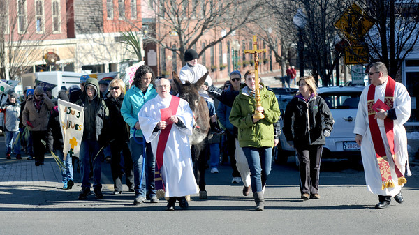 amesbury: The annual Palm Sunday procession makes it's way up Main Street in Amesbury Sunday morning. The event was sponsored by the Amesbury Council of Churches. Jim Vaiknoras/staff photo