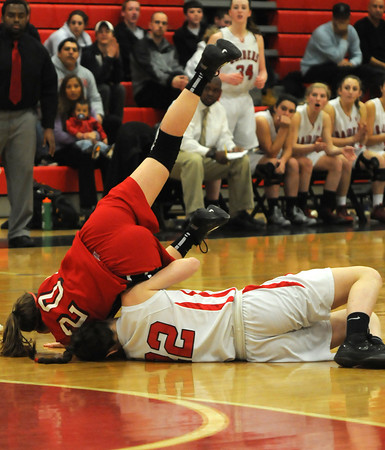 Watertown: Amesbury's Julia Schlich dives for a loose ball with Watertown's Felicia Korte during the Indians loss to Watertown at Watertown high school Sunday. Jim Vaiknoras/staff photo