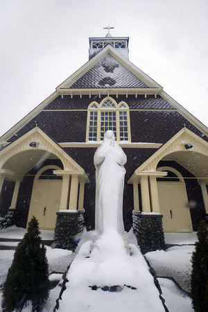 Salisbury: The statue at the Star of the Sea Church at Salisbury Beach is covered with a layer of snow Tuesday morning. JIm Vaiknoras/staff photo