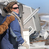 Newbury: Sharon Bresnahan is consoled as she stands on a neighbor's deck on Plum Island, her family home behind her toppled over early Saturday morning due to damage from Friday's storm. Jim Vaiknoras/staff photo