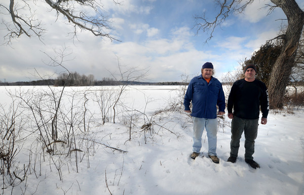 Newbury: Bill and JR Colby at their farm on Scotland Road in Newbury, behind them is the site for a preposed solar farm abutting their land. Jim Vaiknoras/staff photo