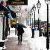 Newburyport: A lone figure huddles under their umbrella as the walk up a windy and snowy State Street in Newburyport Tuesday morning. Jim Vaiknoras/staff photo