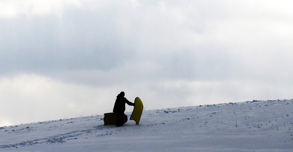 Amesbury: Two kids make their way up the hill with sleds at Woodsom farm Wednesday afternoon. Jim Vaiknoras/staff photo