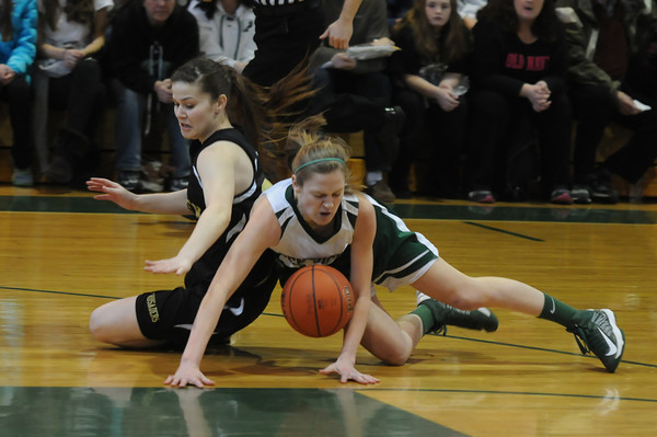 West Newbury: Pentucket's McKenna Kilian and Bishop Fenwick's Gianna Pizzano fight for a loose ball during their game at Pentucket Saturday afternoon. JIm Vaiknoras/staff photo