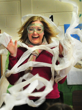 "Newburyport: Brown School principal Amy Sullivan is bombarded by bathroom tissue blown at her with a leaf blower. Captain-Elect Ron from Mad Scientists brought his show ""Up, Up and Away"" to the Newburyport School teaching children about air pressure, vacuums and other air-related science. Bryan Eaton/Staff Photo"