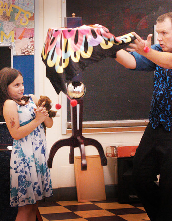 Salisbury: Felicia MacDonald, 8, who was assisting magician Dave Anderson, reacts to the levitation of a table by him. He was performing at the Boys and Girls Club in Salisbury on Wednesday afternoon. Bryan Eaton/Staff Photo