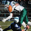 Byfield: Triton's Bradley Whitman forces a fumble on Pentucket's Darren Engelke. Bryan Eaton/Staff Photo