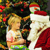 Salisbury: Breanna Dow, 8, of Amesbury chats with Santa Claus at the Boys and Girls Club in Salisbury as they received Christmas presents and had a pizza party. The club will be open during school vacation this Thursday, Friday, Monday and Tuesday. Bryan Eaton/Staff Photo