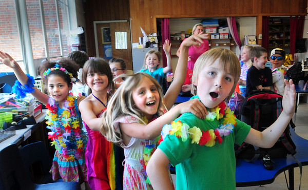 Newburyport: Students in Janis Cahill's second grade class at the Bresnahan School circle the classroom in a Conga line to Carribean music just before they left school to start summer vacation. Bryan Eaton/Staff Photo