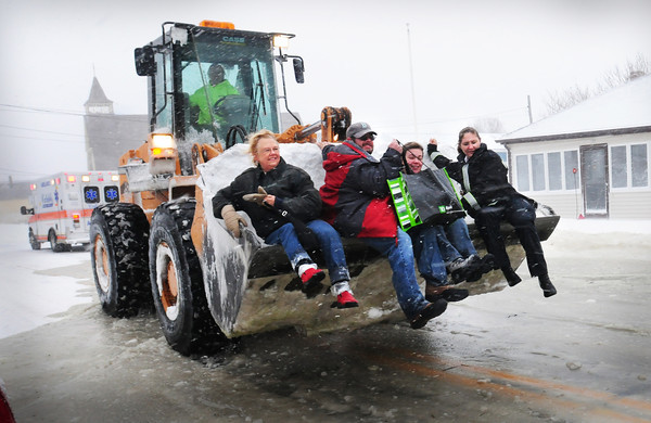 Salisbury: These four people and others were evacuated at Salisbury Beach to an ambulance to take them to the Hilton Center as one home was damaged by a wave and others were threatened. Bryan Eaton/Staff Photo