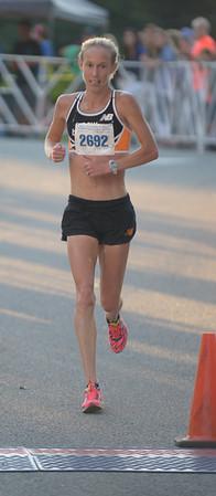 JIM VAIKNORAS/Staff photo Kim Smith woman's winner of the Yankee Homecoming 10 mile road race Tuesday night.
