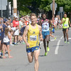 JIM VAIKNORAS/Staff photo.  Kameron Ulmer wins the Men's over all at the High Street Mile.