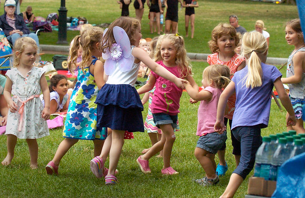 Bryan Eaton/Staff photo. Younsters get into the act the Yankee Homecoming Kids Talent Showcase dancing to the music.