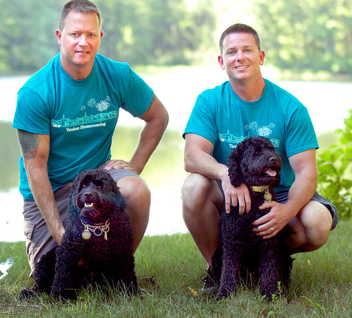 BRYAN EATON/Staff photo. Brothers Tom Cusick, left, with Stitch, and Terry Cusick with Lilo will be in the Yankee Homecoming Pet Parade on Saturday.