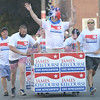 JIM VAIKNORAS/Staff photo. State Representative Jim Kelcourse waves to the crowd as he makes his down Federal Street in the annual Lions Club Bed Race.