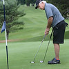 Bryan Eaton/Staff photo. Charlie Noonan of Newburyport putts on the ninth hole.