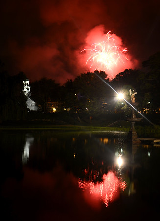 JIM VAIKNORAS/Staff photo  Yankee Homcoming fireworks fill the skies over Newburyport Saturday night as seen from the Bartlet Mall. August 3, 2014