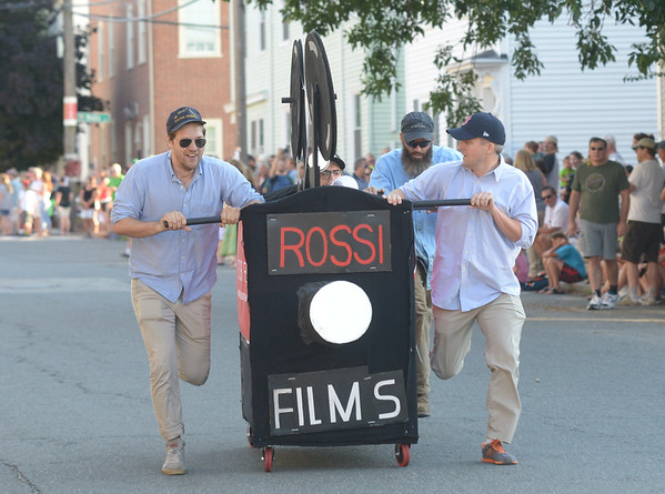 JIM VAIKNORAS/Staff photo. Rossi Films raced a movie camera bed down Federal Street in the annual Lions Club Bed Race.
