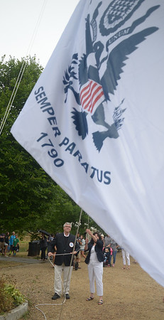 JIM VAIKNORAS/Staff photo Yankee Homecoming General Chairman Paul Swindlehurst and Mayor Donna Holaday raise the Coast Guard flag after opening ceremonies at Old Fashioned Sunday on the Bartlet Mall.