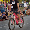 BRYAN EATON/Staff photo. Slow Bike Race winner Alex Dardinksi pulls across the finish line in the final heat.