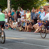 BRYAN EATON/Staff photo. Spectators line Pleasant Street to watch the second celebrity heat of the Slow Bike Race.