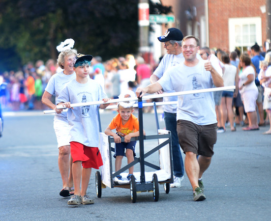 JIM VAIKNORAS/Staff photo. Angels help push the Old South Church bed  down Federal Street in the annual Lions Club Bed Race.