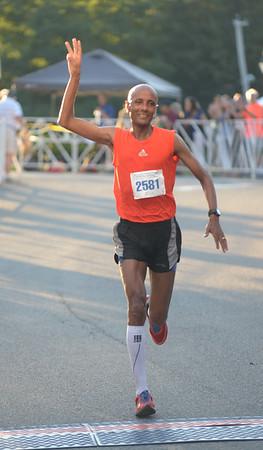 JIM VAIKNORAS/Staff photo Reta Alene male winner of the Yankee Homecoming 10 mile road race Tuesday night.