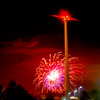 JIM VAIKNORAS/Staff photo The Yankee Homecoming fireworks explode behind the wind turbine at Mark Richie on Parker Street in Newburyport
