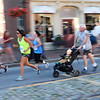 BRYAN EATON/Staff photo. Runners are a blur as they race through Market Square.