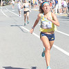 JIM VAIKNORAS/Staff photo EMILY LIPARI  Emily Lipari wins the women's over all at the High Street Mile.