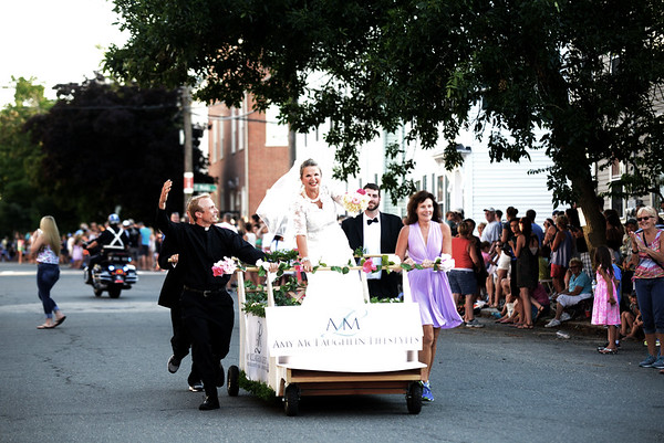 JIM VAIKNORAS/Staff photo. The Amy McLaughlin Lifestyle's bed makes it's down Federal Street with a wedding theme in the annual Lions Club Bed Race.