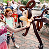 BRYAN EATON/Staff photo. Haley Cotter, 10, of Newburyport takes her balloon monkey made Mr. Dee in Newburyport's Market Square.