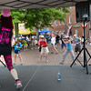 BRYAN EATON/Staff photo. Susan Tribble of Colorful Fitness in Merrimac leads people in Zumba Gold at the Market Square Stage on Tuesday afternoon.