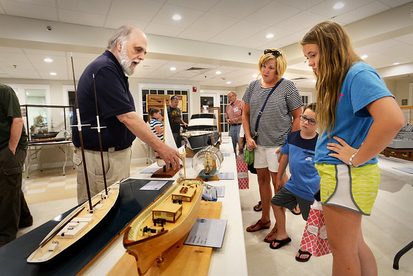 BRYAN EATON/Staff photo. Dave Deinnocentis, member of Merrimack Valley Ship Model Club talks about the different model craft on display at the Unitarian Universalist Church. The display continues until Saturday.