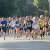 JIM VAIKNORAS/Staff photo Runner take off down High Street at the start of the Yankee Homecoming 5k road race Tuesday.