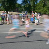 JIM VAIKNORAS/Staff photo Runners sprint by spectators at Sunday mornings  High Street Mile.