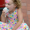 JIM VAIKNORAS/Staff photo. Molly Palen, 4, of Haverhill eats a snowcone as she wait on High Street for the start of  the Yankee Homecoming Parade.
