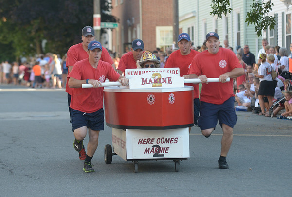 JIM VAIKNORAS/Staff photo. The Newburyport Fire Dept make their way down Federal Street in the annual Lions Club Bed Race.