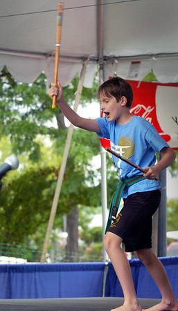 Bryan Eaton/Staff photo. Callum Johnson, 9, of Newburyport goes through karate moves at the Kids Talent Showcase.