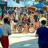 BRYAN EATON/Staff photo. Spectators cheer on the runners as they head through Market Square.